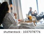 breakfast in bed  cozy hotel...   Shutterstock . vector #1037078776