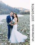 happy bride in a white dress... | Shutterstock . vector #1037109076