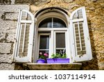 old window at a historic... | Shutterstock . vector #1037114914