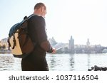 a young tourist man with a... | Shutterstock . vector #1037116504
