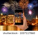 hand photographing fireworks... | Shutterstock . vector #1037117860