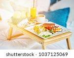breakfast in bed  cozy hotel...   Shutterstock . vector #1037125069