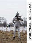 tall man in wearing grey... | Shutterstock . vector #1037139556