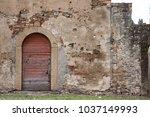 red door in old abandoned...   Shutterstock . vector #1037149993