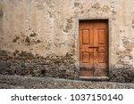 old door in ancient medieval...   Shutterstock . vector #1037150140