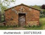 old door in ancient medieval...   Shutterstock . vector #1037150143