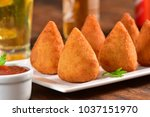 coxinha on rustic bar table | Shutterstock . vector #1037151970