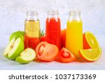 bottles with fresh orange ... | Shutterstock . vector #1037173369