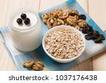 on a wooden table muesli  nuts...   Shutterstock . vector #1037176438