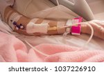 Small photo of Close up of a patient's hand with Total Parenteral Nutrition (TPN) being administered into vein