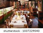 setting tables in retro... | Shutterstock . vector #1037229040