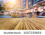 wooden floor front of bokeh... | Shutterstock . vector #1037235853
