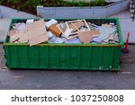 construction waste in an metal... | Shutterstock . vector #1037250808