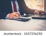 a businessman analyzing... | Shutterstock . vector #1037256250