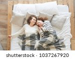 mom and daughter lie in a white ... | Shutterstock . vector #1037267920