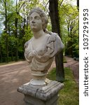 antique bust in the summer... | Shutterstock . vector #1037291953