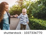 happy young woman with her son... | Shutterstock . vector #1037336770
