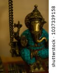Small photo of Yoga studio details. God icons and statues for praying and mantra singing. Indian atmosphere and harmonious ambiance.