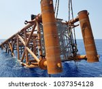 Small photo of Oil and gas jacket during upending process, before the jacket is ready to be lowered down to seabed for installation