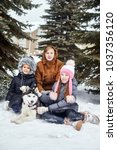 children sit in the snow and... | Shutterstock . vector #1037356120