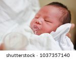 infant baby is belching after... | Shutterstock . vector #1037357140