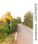 Small photo of Crossroads sign, warns of an intersection ahead. intersection ahead countryside