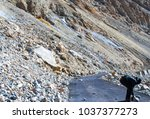 fallen rocks on the smooth... | Shutterstock . vector #1037377273