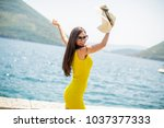 young attractive woman with a... | Shutterstock . vector #1037377333