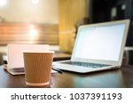 coffee cup and laptop on the... | Shutterstock . vector #1037391193