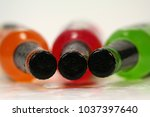 Small photo of Close up Three Cold Soft Drink Bottle Abreast on White Table