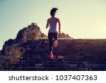 woman trail runner running... | Shutterstock . vector #1037407363