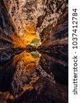 green cave   cueva de los... | Shutterstock . vector #1037412784