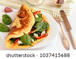 omelet with spinach  ricotta... | Shutterstock . vector #1037415688