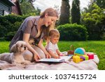 young mother with one year... | Shutterstock . vector #1037415724