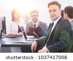 business team with a senior... | Shutterstock . vector #1037417008