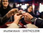 group of people toasting in a... | Shutterstock . vector #1037421208