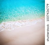 beautiful white sand beach and... | Shutterstock . vector #1037426779