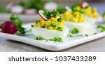 stuffed eggs with avocado ...   Shutterstock . vector #1037433289