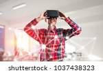 young man with virtual reality... | Shutterstock . vector #1037438323