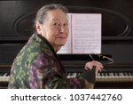 old smiling lady pianist... | Shutterstock . vector #1037442760