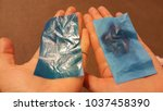 Small photo of Two women hands holding one blue oil absorbing sheets which soak up excess oil from oily skin and one oil control film which is little oil from normal skin or combination skin during working day.