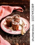 chocolate mousse in a jar ... | Shutterstock . vector #1037492389