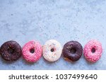 donuts with icing on pastel... | Shutterstock . vector #1037499640