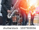 World Jazz festival. Saxophone, music instrument played by saxophonist player and band musicians on stage in fest.