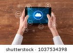 hand touching tablet with cloud ... | Shutterstock . vector #1037534398