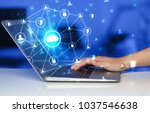 hand using laptop with... | Shutterstock . vector #1037546638