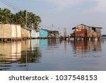 houses on stilts in the village ... | Shutterstock . vector #1037548153