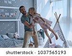 he makes her fly. full length... | Shutterstock . vector #1037565193