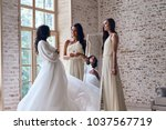 amazed by brides beauty. two... | Shutterstock . vector #1037567719