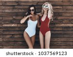 girls only  full length of two... | Shutterstock . vector #1037569123
